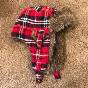 trapper hat with cute red flannel exterior